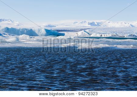 Icebergs drifting to sea in Jokulsarlon Iceland