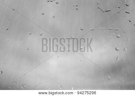 Raindrops, Water drops on a dusty window in monochrome