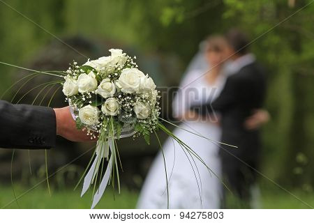 Wedding Bouquet With The Wedding Couple
