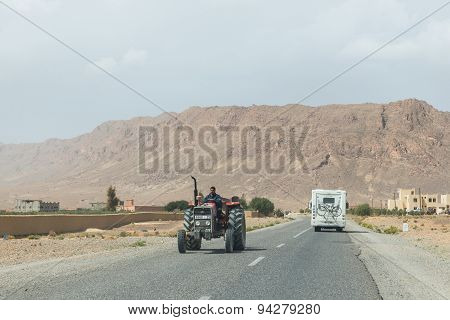 The Farmar Rides Truck By In Opposite Directions With Recreational Vehicle Of Tourist