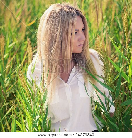 Young Beautiful Woman Poses In Green Thickets