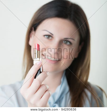 Portrait Of Young Woman Applying Lips Make Up