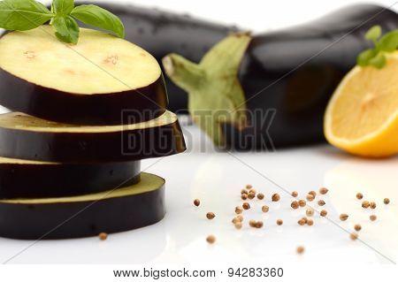 Sliced Aubergine, Eggplant With Basil Leaves And Coriander Seeds,lemon