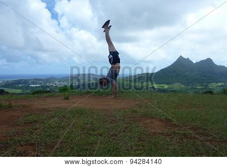 Man Handstands At Pali Highway Lookout Point