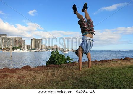 Man Handstanding Along Shore Of Magic Island