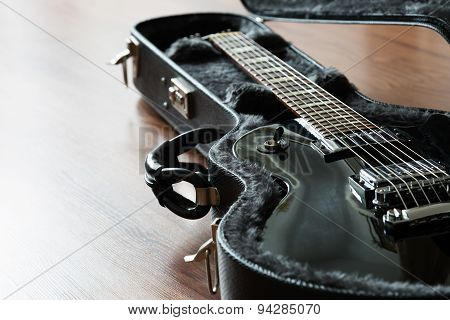 Electric guitar in the case