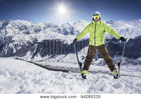 Young men on skies in winter mountain resort