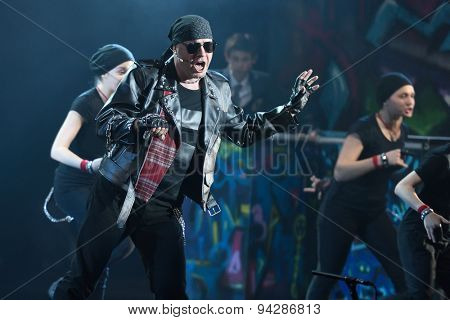 ST. PETERSBURG, RUSSIA - JUNE 19, 2015: Singer Alexey Kortnev performs in a scene from a children's charity project titled Mowgli Generation. The performance is part of the SPIEF 2015