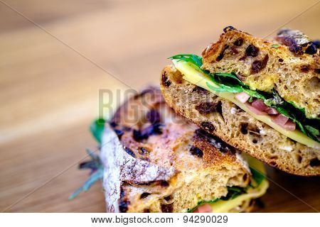 A deli sandwich on rustic bread