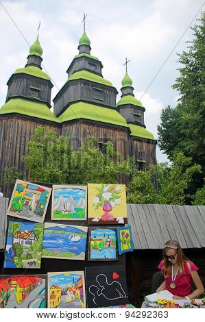 Ukrainian Artist Near Wooden Orthodox Church In Museum Pirogovo, Kiev, Ukraine