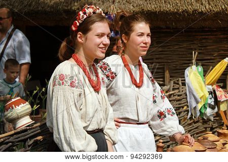 Two Young Beautiful Girls In Outdoor Ethnic Village Pirogovo, Kiev, Ukraine