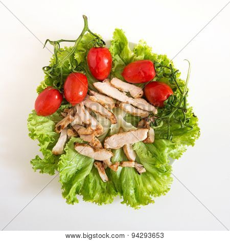 Green Healthy Salad Witch Chicken And Tomatoes On A Blank Background