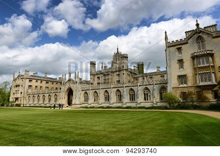 CAMBRIDGE, ENGLAND - MAY 13: Architectural Exterior of St Johns College New Courth Gateway on Green Lawn with Cloudy Blue Sky Overhead on May 13, 2015