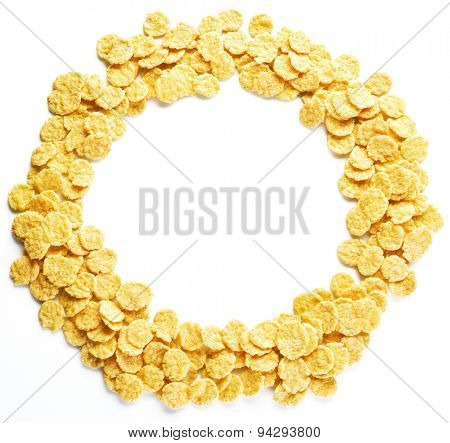 Cornflakes round on a white background.