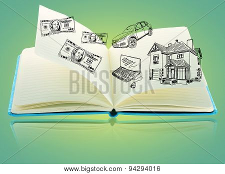 Open book with drawings on green background