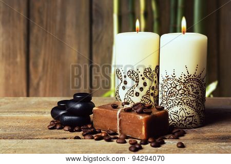 Beautiful spa composition with decorative Indian candles on wooden background