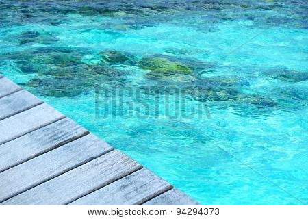 Wooden pier with blue sea background