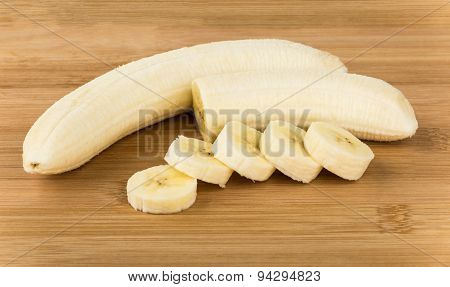 Peeled From Peel Of Ripe Banana And Pieces On Board