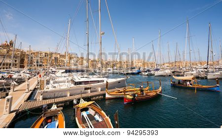Valletta, Malta - 25 May 2015: many yachts and boats in tha bay near Valletta pot in Malta