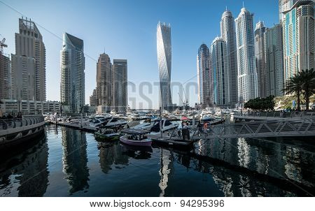 Dubai, United Arab Emirates - December 14, 2013: Panoramic view with modern skyscrapers and water channel of Dubai Marina, United Arab Emirates