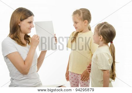 Mom Shows The Kids A White Sheet Of Paper