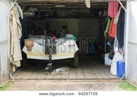 The Garage With A Motor Boat Inside