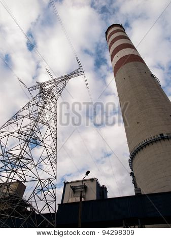 Tall Concrete Chimney And High-voltage Pole