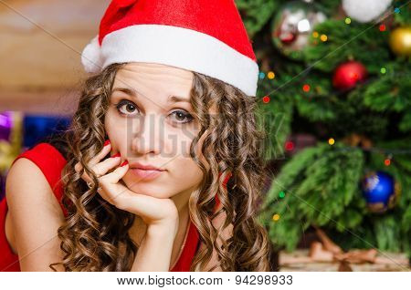 Portrait Of Pensive Girl In A Christmas Setting