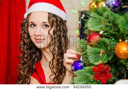Young Girl Dresses Up Christmas Tree