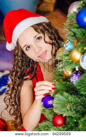 She Hangs Christmas Balls On The Christmas Tree