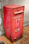 foto of postbox  - Red vintage postbox Through the use of a long time - JPG