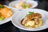 picture of mashed potatoes  - Grilled beef sausages with mashed potato with gravy sauce - JPG