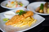 stock photo of tartar  - fish and chips served with tartar sauce and vegetables - JPG