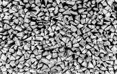 foto of firewood  - Closeup of chopped firewood in a stack ready for burning in monochrome - JPG