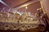 stock photo of champagne glasses  - Capture of Many glasses of champagne on table - JPG