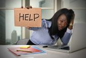 stock photo of secretary  - black African American ethnicity tired and frustrated woman working as secretary in stress at work business district office desk with computer laptop asking for help in frustration concept - JPG