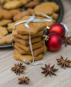 pic of christmas cookie  - Christmas Gingerbread Cookies homemade on wooden table - JPG