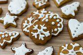 foto of christmas cookie  - Christmas Gingerbread Cookies homemade on wooden table - JPG