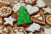 foto of christmas cookie  - Christmas Gingerbread Cookies Tree homemade on wooden table - JPG