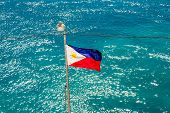 picture of flag pole  - Philippines Flag on Pole Over aqua ocean - JPG