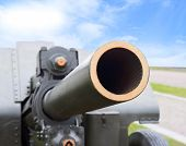 picture of artillery  - Artillery gun of World War II on background blue sky - JPG