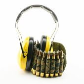 foto of rifle  - yellow ear protection and camouflage ammunition belt for rifle - JPG