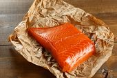 pic of salmon steak  - Salmon steak on old vintage papper. Close-up. ** Note: Shallow depth of field - JPG