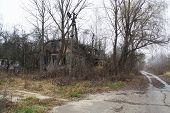 picture of abandoned house  - a Abandoned house and road in the countryside - JPG