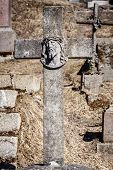 foto of cemetery  - Old concrete cross with face of Jesus Christ in Rasu cemetery Lithuania - JPG