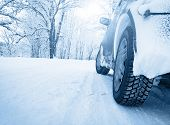 picture of slippery-roads  - car tires on witer road in snowy morning - JPG