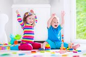 pic of preschool  - Preschooler child playing with colorful toy blocks - JPG
