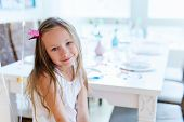 image of princess crown  - Adorable little girl with princess crown at kids birthday party - JPG