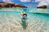 foto of virginity  - Split photo of young woman snorkeling in turquoise ocean water among granite boulders on Virgin Gorda - JPG