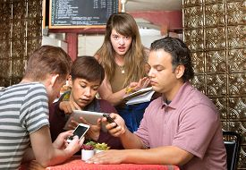 image of ignore  - Rude diners ignoring waitress in a coffee house - JPG